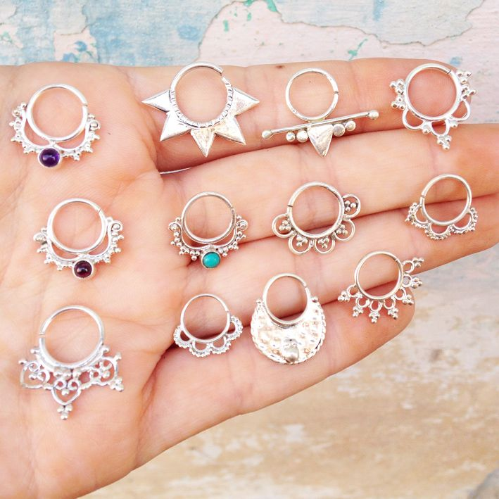 EPIC 92.5% silver handmade septum rings! Select the style you'd like from the drop menu below! HALF PRICE POSTAGE OVERSEAS: Unfortunately we can't change our postage costs online but we will refund you HALF your postage cost if you order septum rings only! Refund will be done by the method of which you paid within 1-2 working days of placing your order and can take up to 3 days! Australian postage via express post!