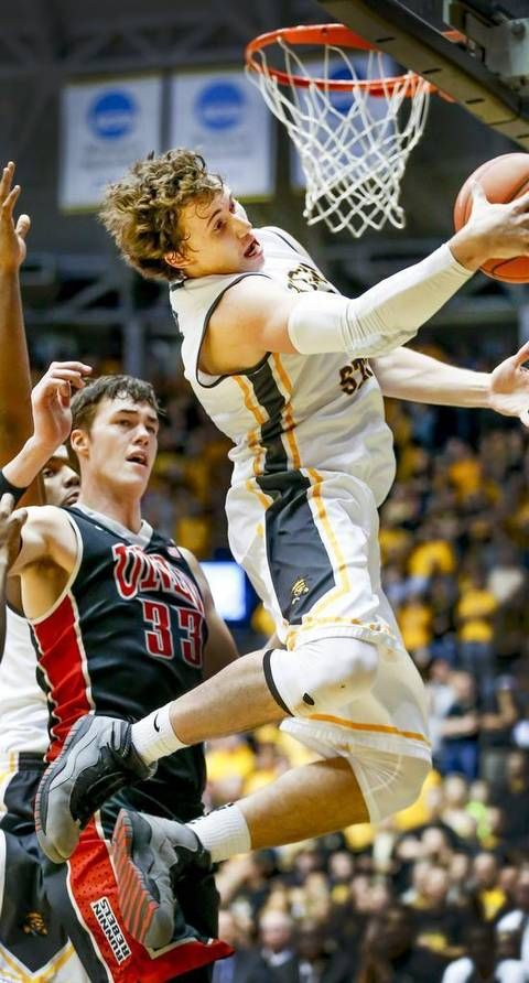 Wichita State's Evan Wessel out rebounds UNLV's 7-footer Stephen Zimmerman in the second half at Koch Arena Wednesday. (Dec. 9, 2015)