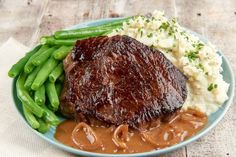 Sirloin Steak with Sauce Robert with Bleu Cheese Mashed Cauliflower and Green Beans. No, it's not a sauce named after your weird uncle or your childhood crush - sauce Robert (imagine how the French might say it: Roh-bear) is a brown mustard sauce with shallots and white wine, a classic in French cuisine. It's served over and under a seared sirloin and next to mashed bleu cheese and chive cauliflowers. Yum yum.