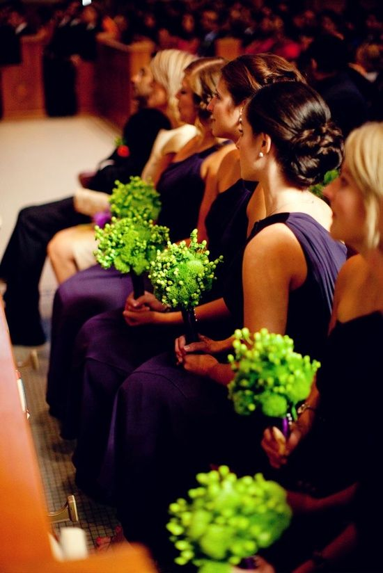 purple bridesmaid gowns and green bouquets