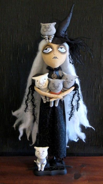 Hah! Good inspiration for a knitted crazy cat lady doll :D
