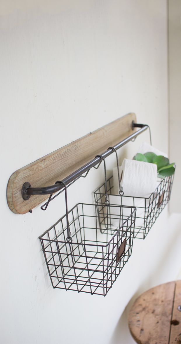 Hang tight. This handy wall addition is about to solve your current organizational conundrum. With two sizable wire baskets, this Anderson Wall Bracket will hold anything from spare toilet paper rolls ...  Find the Anderson Wall Bracket, as seen in the Guest-Ready Home: Rustic Farmhouse Collection at http://dotandbo.com/collections/styleyourseason-guest-ready-home-rustic-farmhouse?utm_source=pinterest&utm_medium=organic&db_sku=114544