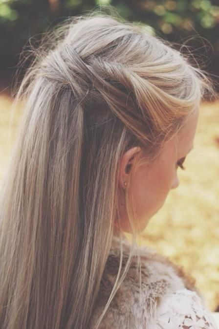 Blonde hair with brown lowlights, bangs pulld back and pinned with bobby pins