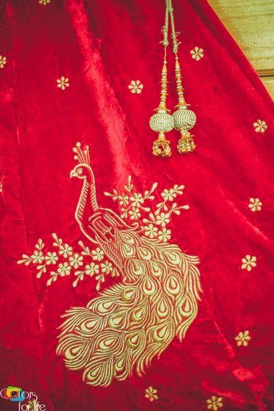 Bridal Details - Red Velvet Lehenga with Golden Embroidery Peacock Detailing | WedMeGood #wedmegood #indianbride #indianwedding #bridal #embroidered #peacock #gold