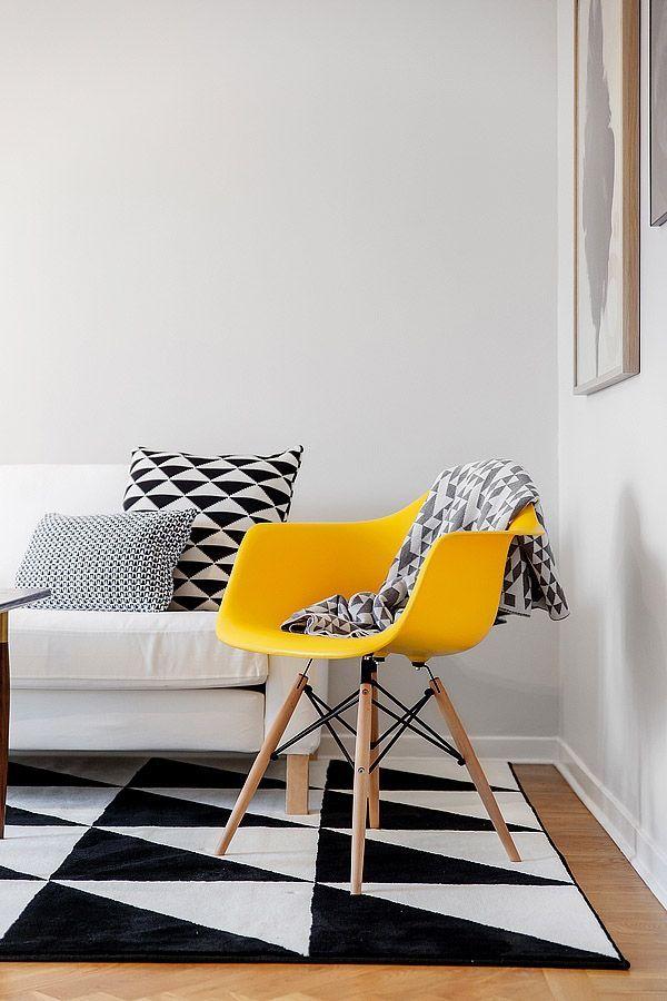Bright yellow Eames rocker on black & white graphic Ikea rug