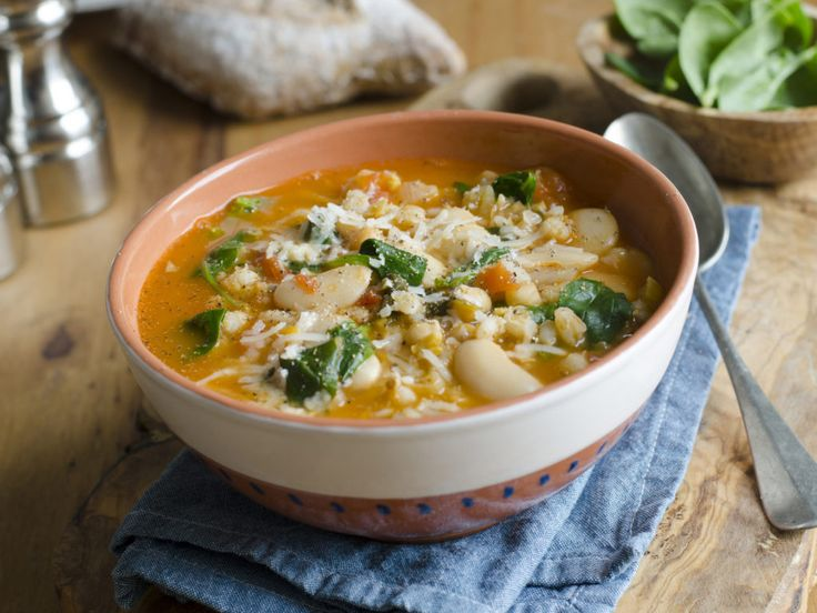 Pearl barley, butter bean and chickpea soup topped with grated Parmesan