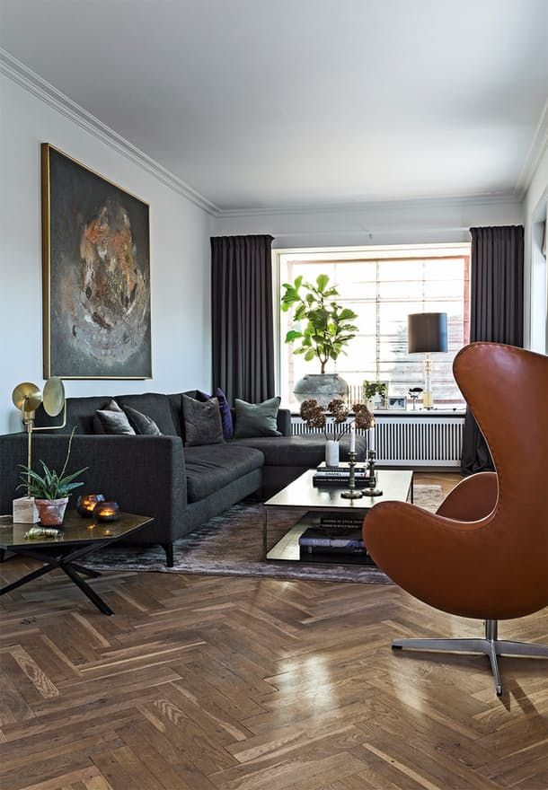 Modern living room with a cognac colored The Egg Chair designed by Arne Jacobsen.