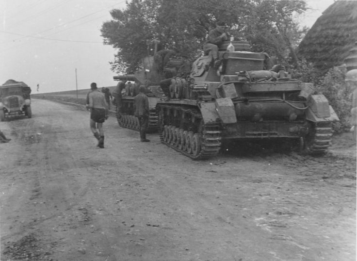"""Two German tanks """"Panzer IV"""" model on a Russian road."""