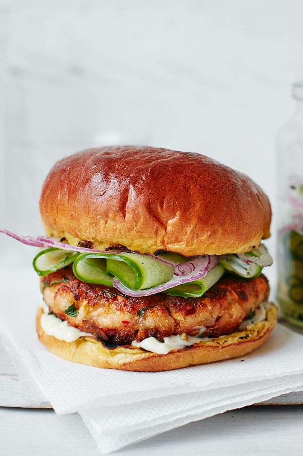 This delicious fish dish uses Asian spices to create a flavoursome burger, made with fresh salmon fillets, zesty lime and fiery red chilli. Rustle it up in under an hour for a tasty midweek dinner for the family. | Tesco