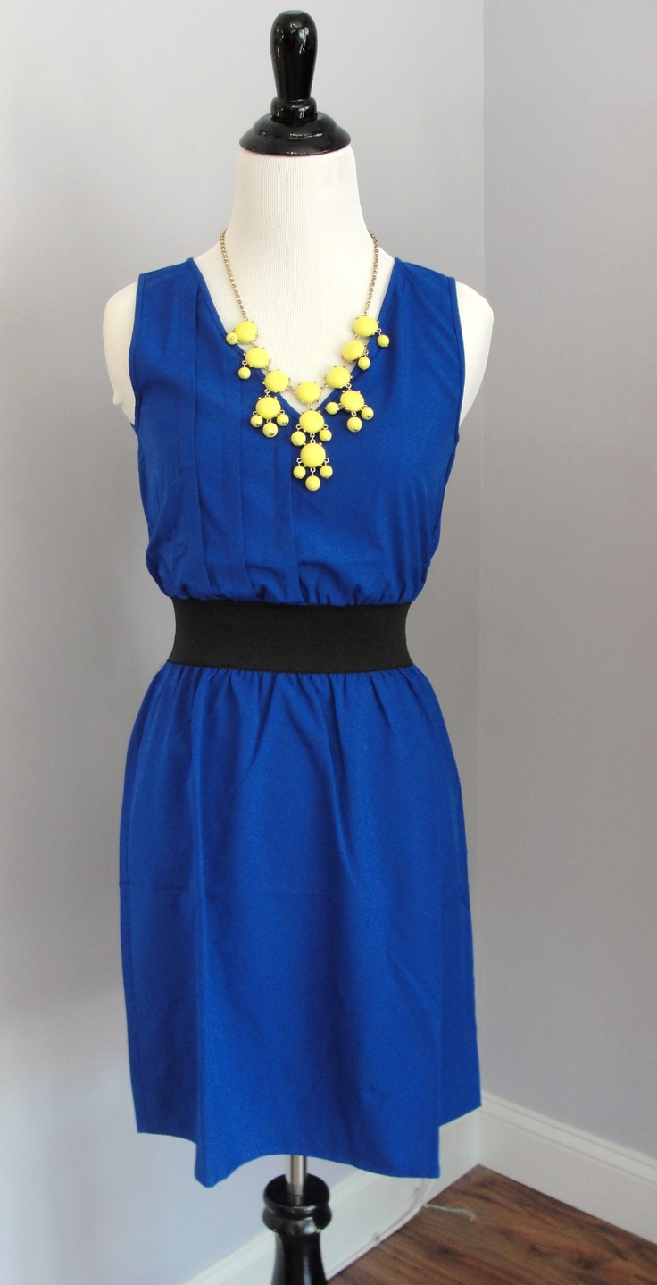 Colbalt blue dress with yellow bubble necklace at Every Occasion Boutique!