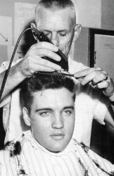 Elvis getting his military haircut at Fort Chaffee, Ark
