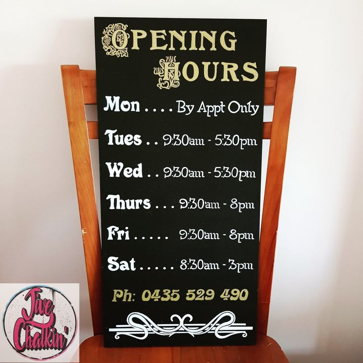 An opening hours chalkboard sign ready to go for Jarrah Hairdressing in Manly.