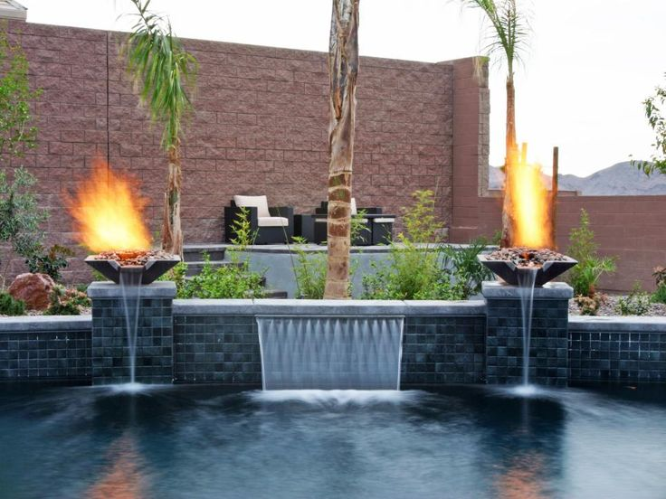 Surrounded by palm trees, fire and a small waterfall, this stunning pool is simply a tropical paradise. Paragon Pool's signature WetFlame combination water vessels and fire elements placed on raised pedestals bookend the 42-inch water feature.