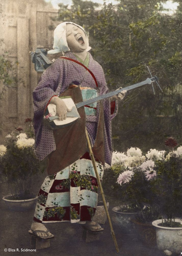 Gose playing a shamisen, 1912 by Eliza R. Scidmore