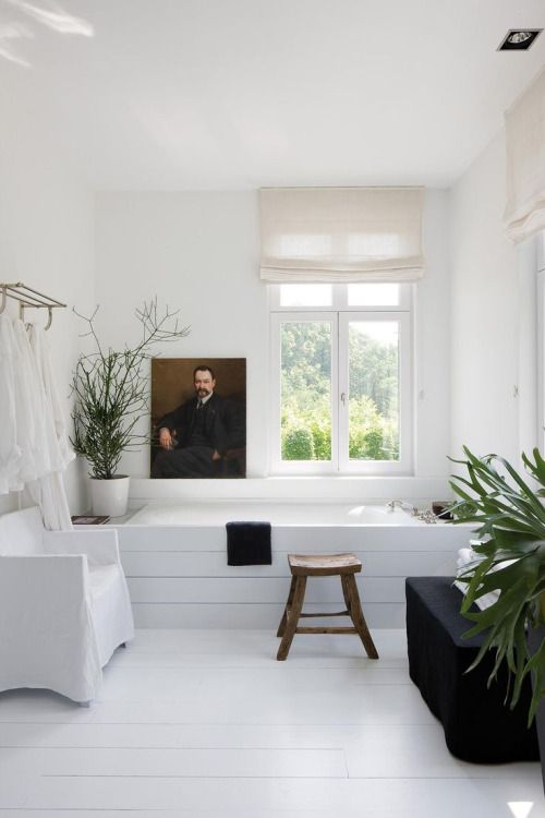 White bathing space with dark accents