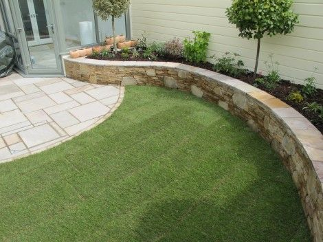 The best line for a raised bed in the garden is often a curve.
