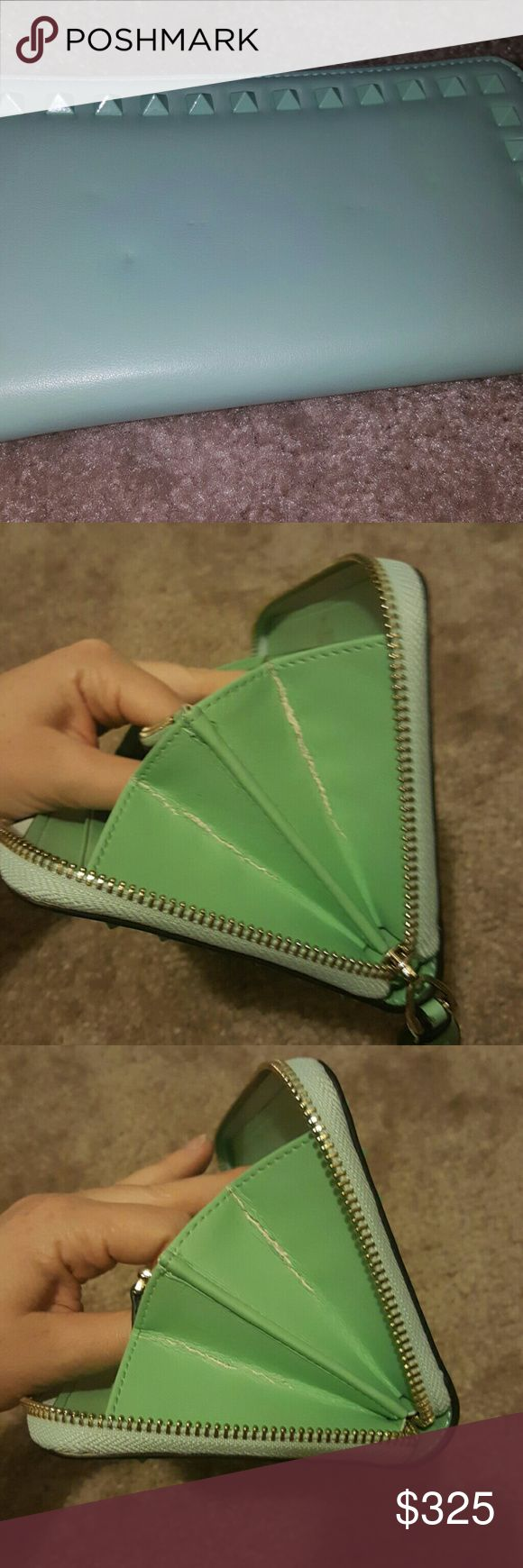 Additional Photos of Valentino Wallet Lightly used AUTHENTIC Valentino Rockstud Wallet in Mint Green. Very rare color and beautiful wallet. Front looks unused where as the back has some marks. They arent very noticable. Second listing shows wear! Rockstuds all in tact. BEAUTIFUL CLASSIC piece. NOT interested in trading :) (unless it is for other Rockstud pieces, st laurent or all saints) Valentino Bags Wallets
