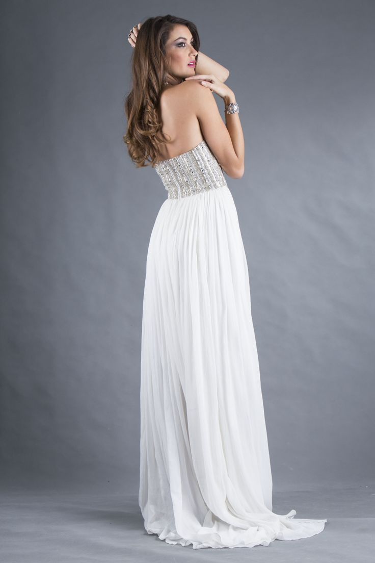 This dress is the embodiment of simplicity and harmony. The strapless bodice is delicately draped with perfectly placed horizontal beaded lines that shape the silhouette, creating a nipped-in waist. The luxurious pleats of the skirt fall into soft folds that create a seductive and elegant effect. This lightweight, fluid dress will be an elegant choice for your special event. Emphasize your bare shoulders with drop earrings and an up do.  www.roxciistore.com