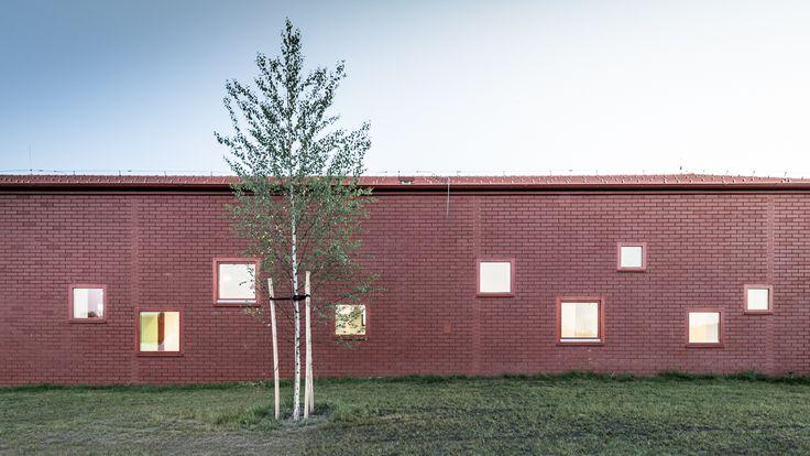 """Daycare in Nagykovácsi by Földes Architects  """"Playfully scattered quadratic windows allow view for children as well as for adults and create an exciting internal atmosphere.""""  """" A játékosan kialakított négyzetes ablakok, amin a kicsik és a nagyok egyaránt kiláthatnak, izgalmas atmoszférát hoznak létre a belső térben.""""     #foldesarchitects #daycare #nursery #hungary #architecture #brick #nagykovacsi #bölcsöde #óvoda #építészet #üveg #tégla"""