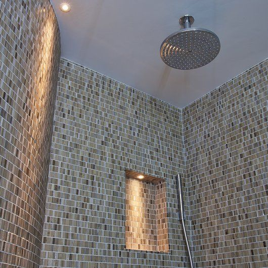 Let subtle niche lighting softly beckon you in to your revitalising rainforest shower. Bliss.