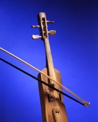 Hand-made wood violin from Las Vegas, N.M. Mid-19th century. History Collection NMHM, DCA, 2626/45. Photo by Blair Clark, New Mexico Department of Cultural Affairs.