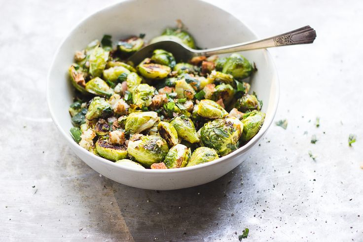 Crispy Brussels Sprouts Breadcrumbs with Shallot + Sage | Crispy brussels sprouts topped with warm ghee sautéed shallots, sage and toasted gluten-free breadcrumbs. It basically tastes like stuffing in a bowl.