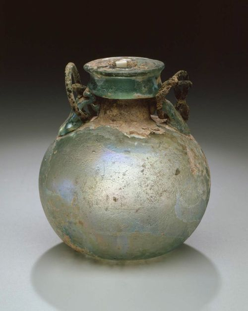 Roman, Oil flask, 1st-2nd century -Glass; free-blown with attached glass and bronze handles; wheel-cut lines around center of body - Boston Museum of Fine Arts