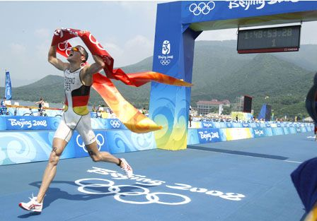 Crossing the finish line is the crowning achievement for a triathlete. Prizes are nice, too. Germany's Jan Frodeno, pictured here, claimed the gold medal in the 2008 Olympics in Beijing.