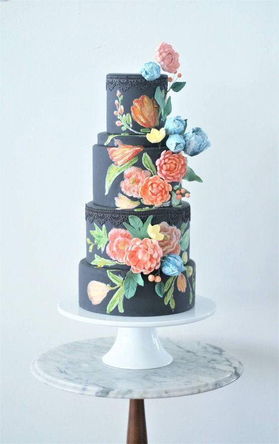 Featured Cake: The Cocoa Cakery; Floral printed black wedding cake idea.