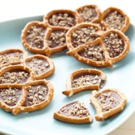 Nutty Candy Filled Pretzels  - not sure what the candy melts are - but thinking choco chips or other would work fine.