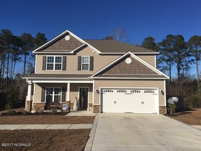 215 Riverstone Court. Jacksonville, NC 28546 **$204,900** Call Ray Evans at 910-381-4632. RE/MAX Elite Realty Group  Sterling Farms welcomes the Sydney floor plan. At over 2100 heated square feet, this 4 bedroom, 2.5 bath home has a charming exterior that includes an accent of brick and a large covered front porch! The foyer is sure to impress and flows perfectly into the formal dining room with coffered ceiling, perfect for all of those special occasions.