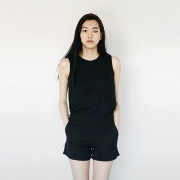 [Merci Romper: Black] A #romper featuring an exposed zipper placket at back. Round neckline. Sleeveless. Elasticized waist. #jumpsuit #blackdress #chic #koreanfashion