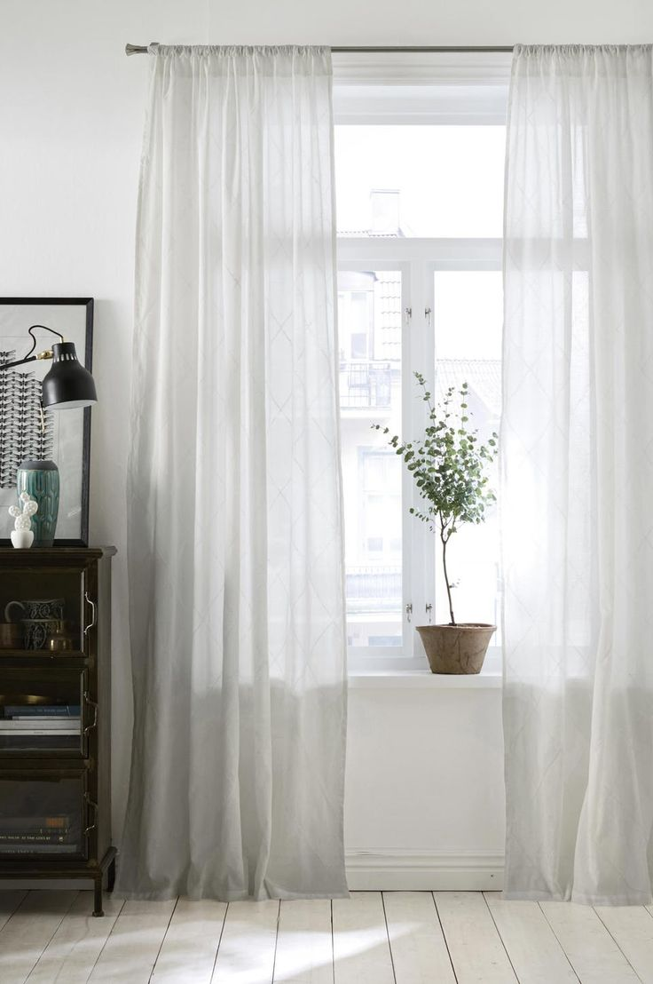 Give your rooms a bright airy feeling with thin white curtains, that goes all the way to the floor.