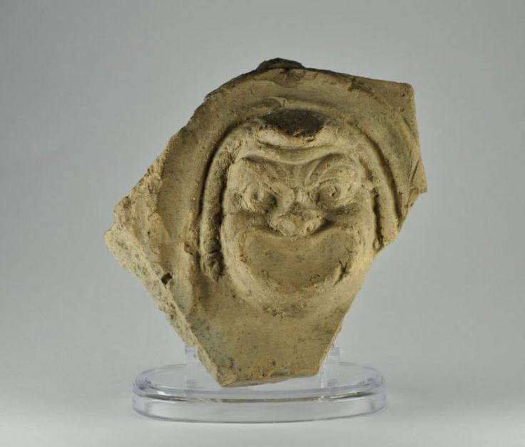 Roman antefix with actor mask, 1st century B.C.- 1st century A.D. Roman pottery antefix with actor mask, 13.9 cm high. Private collection