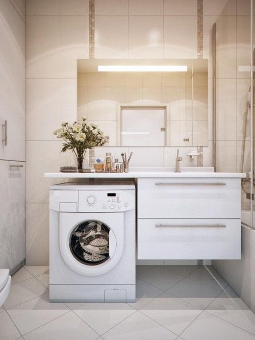 How to incorporate your washing machine into the design of your bathroom! Clever! Also, site has some beautiful bathroom inspiration...