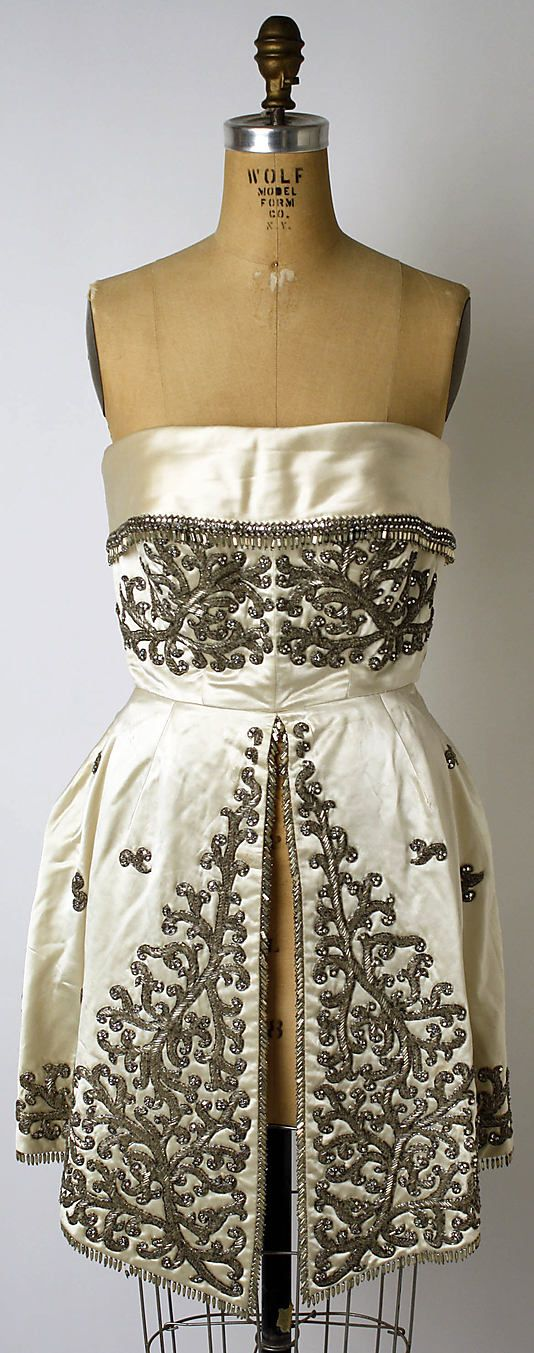 Christian Dior evening dress from fall/winter 1958-1959 by designer Yves Saint Laurent. Made with metallic patterned flower embroidered beadwork with silk, glass beads, and cotton. House of Dior. #HauteCouture