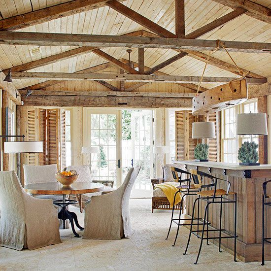 Built for Entertaining - pair of chaide longues, rustic plank walls, exposed beamed ceilings