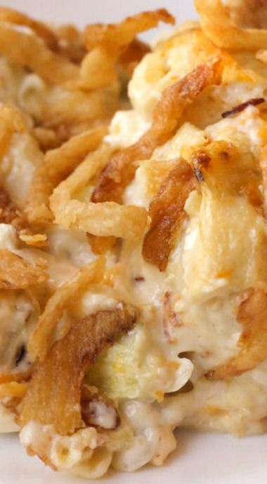 FRENCH ONION CHICKEN CASSEROLE ~ 3 c. chopped cooked chicken...1 c. chopped celery (or french style green beans)...1 c. shredded cheddar cheese...1 c. sour cream...1 c. mayo...1 can cream of chicken soup...1/2 C.slivered almonds...1 (6 oz. )French fried onion rings