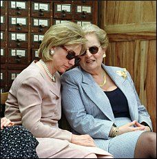 June 1998: First lady Hillary Clinton listens to U.S. Secretary of State Madeleine Albright at a book donation ceremony at Peking University(Reuters/Natalie Behring)