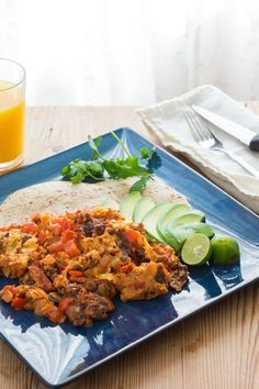Tex-Mex style Migas made with eggs scrambled with tortillas, onions, peppers, chorizo, salsa and cheese.