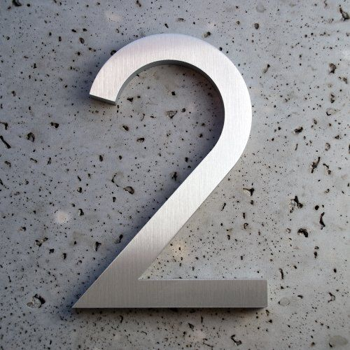 "Modern House Number Aluminum Modern Font Number Two 2 - 8 inch by Moderndwellnumbers.com. $35.99. Size 8"" Tall. Recycled 3/8"" thick aluminum billet. Modern House Numbers. Modern font. Clear protective coating to withstand extreme conditions. We provide high quality house numbers. All of our house numbers are made from recycled 3/8"" thick aluminum billet. available sizes 4"" 6"" 8"" 12"" 15"" tall, with 1/2"" standoffs standoffs and installation template. Each number has a brushe..."