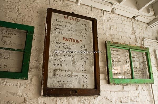 Interior design of the cafe, DolceZZa in Washington DC - old window frames as menu boards on a whitewashed brick wall.