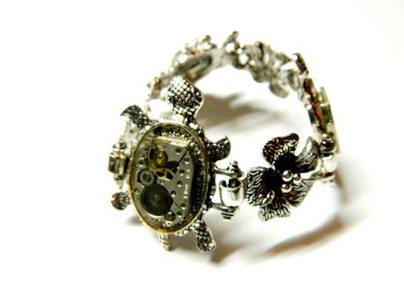 Silver colored metal cuff bracelet Turtles by EmilySteampunk