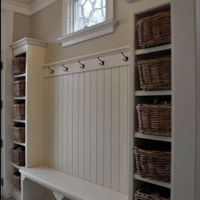 Hallway type mud room idea - like the hooks, wainscoating  bench. One side with low hooks for kids, one on the other side normal height for adults