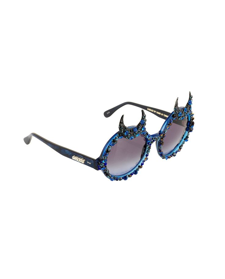 A-MORIR HAGEN BLUE SUNGLASSES Sunglasses round frame with moon-shaped horns hand carved acetate frame UV400 premium Italian lens hand applied Swarovski rhinestones blue hand made hematite moons hand made