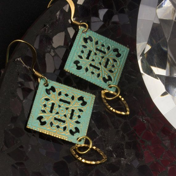 Beautiful! This lovely earrings are a perfect gift for that special someone. These Verdigris filigree square dangle earrings are finished with a diamond cut marquise loop, pulled together on a gold plated french hook. These earrings can be paired up with a matching locket (seen in picture #3) and can be found on the link below. 614923EG