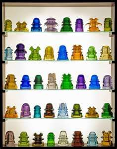 Glass insulators were first made in the 1840's to support telegraph lines. Later as time went on they were used for telephone lines, power lines, and any electric ...