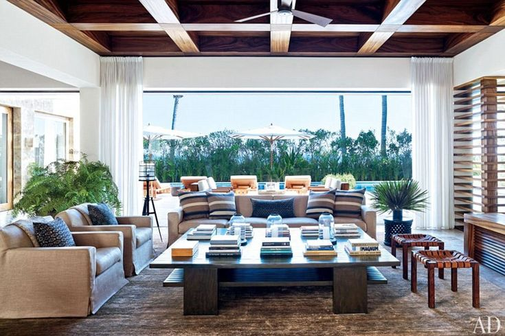 He could fit all 13 Oceans in here: The Oscar winner's living room has doors that open up to an outdoor living area complete with a pool and...