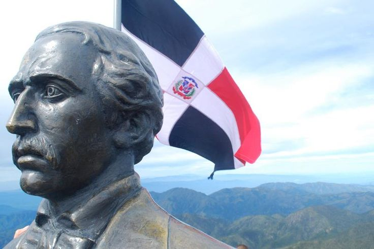 Juan Pablo Duarte bust and Dominican flag. Duarte is one of the Founding Fathers of the Dominican Republic.