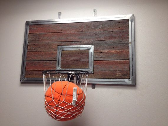 Wall Mounted Basketball Hoop made to order! 2/3 scale of a regulation hoop, we can do the backboard in red, blue or natural wood. Rustic barn wood mixed with metal to create this unique look. Head on over to our Esty shop and check it out! https://www.etsy.com/listing/200614869/wall-mounted-basketball-hoop?ref=shop_home_active_1
